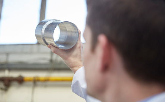 Safety Health and Quality image man inspecting tube metal